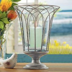 """* For the Canadian PartyLite Lover *  **** Available until July 31, 2013****  Garden Sanctuary Wire Hurricane Set Item #:  P95546 A grand, urn-inspired metal holder detailed with Gothic arches nestles a textured, bubble glass hurricane inside. Can also use each piece individually. Add your own pillar candles or jar candles for a mesmerizing glow. 14 1/2"""" (37 cm) h, 11"""" (28 cm) diam. ~ Click through to order now! (Scheduled to return in 2014)"""