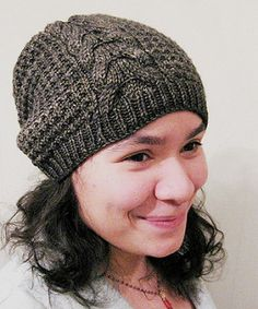 Fun slouch hat with a cable that continues up into the crown.
