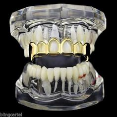 Image result for gold grillz fangs