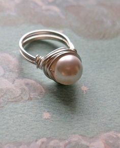 Really like!! White Pearl Ring by puffluna on Etsy, $14.00