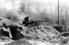 Polish insurgent using a Wz. 35 anti-tank rifle - Huge Collection Of The Warsaw Uprising Photos 18  Best of Web Shrine