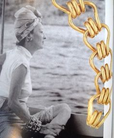 "Mrs. Alfred P. Knopf, wearing her infamous set of ""3"" very heavy Seaman Schepps gold 'Mousetrap' bracelets."