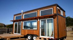 A couple is building their tiny dream house on wheels on the back of a flatbed truck in Guelph, Ont. But the little house will be bigger than what they're used to living in.