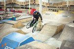 Anthony Napolitan styles through a jump line at the Red Bull BMX Performance Camp at Joyride 150 in Toronto, Canada,