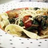 When I was growing up, my mother used to make a simple dish of fried tomatoes and onions that we would soak up with buttered bread. This is an updated version to which I have added mushrooms and fresh basil. My daughter loves this over whole wheat penne pasta and topped with Parmesan cheese.