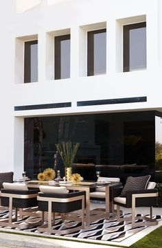 Grounded by a thick aluminum frame in our metallic Asti finish, a tempered glass top of our Mercer Dining Collection seems to float above. | Porta Forma Dining Set, Fine Dining, Dining Table, Porches, Outdoor Spaces, Outdoor Decor, Outdoor Stuff, Modern Outdoor Living, Outdoor Restaurant