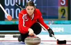 Denmark's skip Lene Nielsen, delivers the rock while Maria Poulsen, right, sweeps the ice during the women's curling match against South Korea at the 2014 Winter Olympics, Sunday, Feb. 16, 2014, in Sochi, Russia. (AP Photo/Wong Maye-E)