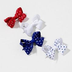 Show your patriotic style this 4th of July with star-print red, white & blue Bow Hairclips $6.00