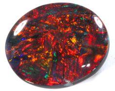QUALITY BLACK SOLIDOPAL LIGHTNINGRIDGE 1.55 CTS JJ-20, Red is the most valued color in a black Opal