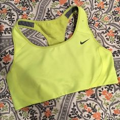 Nike Sports Bra Medium support bra with mesh design on the back. Bright yellow and so cute! Worn only a few times it just doesn't fit me anymore sadly. Bundle me for a better price! Also check out my other workout apparel! Nike Intimates & Sleepwear Bras