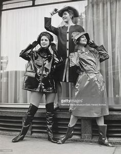 Left to right Judy Wilson wearinng a PVC zip-fronted jacket with detachable throat tab; Nicky Allen shows a coat with contrasting button panel; and Avril Humphrey is wearing a PVC coat with standaway collar. Vinyl Raincoat, Pvc Raincoat, Shiny Boots, Rain Cape, Shiny Fabric, Pvc Coat, Raincoats For Women, Satin Skirt, Unisex