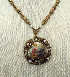 Vintage floral pendant necklace, Estate Jewelry, 1960s Retro Jewelry by theglassfeathernest on Etsy https://www.etsy.com/listing/266808890/vintage-floral-pendant-necklace-estate