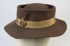 Women's Land Army hat with grosgrain ribbon band and WLA hat badge.