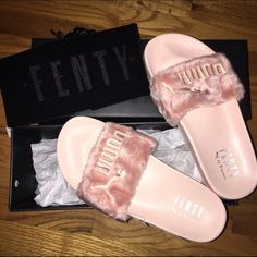 "Rihanna ""FENTY"" Puma Leadcat Furry Slides in PINK! BRAND NEW. NEVER WORN. Rihanna furry pink puma slides! Comes with tags, box, and bag. Size 5.5 but these run large and are too big for my feet. I'd say these fit more like a 6-6.5. These just came out yesterday 4/22. And already are sold out EVERYWHERE!!! Please message me for more info. Puma Shoes Slippers"