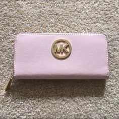 Sale! Michael Kors zip around wallet light pink Brand new! Comes with gift box! 100% authentic, purchased from Michael Kors. Can provide receipt upon request. 119 Michael Kors Bags Wallets
