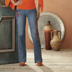 Feather Jean by Midnight Velvet Style.   Jeans are embellished with embroidered feathers in lively sunset hues.