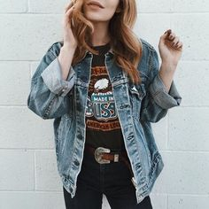Cool girl in a denim jacket with a metal belt buckle