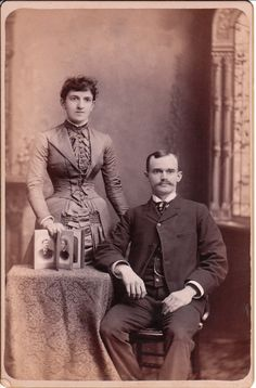 This cabinet card features a well dressed young couple posing for their portrait in the studio of Stephen Piper in Manchester, New Hampshire.