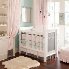 Ritzy Baby Nursery Bedding by Carousel Designs. Crib bedding combining pink damask, robin egg blue, and dark gray for your baby girl's nursery.