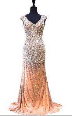 The luxurious mermaid gown with a beaded, floor-length,