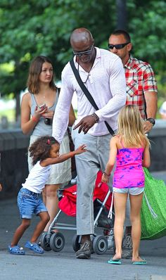 Seal takes a walk with his daughters Leni and Lou on July 15, 2012