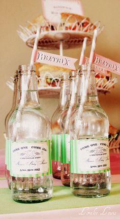 reused glass soda bottles with custom labels printed on waterproof paper