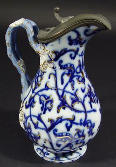 Victorian flow blue china jug with pewter mount and grapevine design handle.