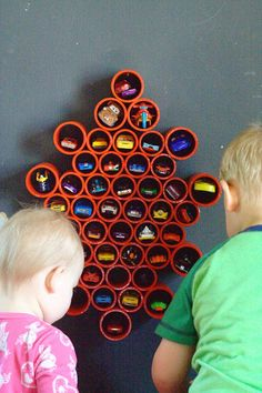 DIY Toy storage idea and DIY Toy Organization idea for the playroom. Organize all of your boys' Matchbox with this DIY Matchbox Car Storage for the wall. It's super easy and the kids will love it! (and you'll love it too, when there is no longer a Matchbox car explosion all over your playroom.