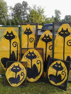 Halloween-themed painted window screens with black cats