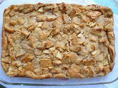 Apple Bread Pudding  5-6 c. stale French bread cubes (about 1/2 of a standard loaf cut into 1″ cubes) 3 c. apples, peeled and chopped into small pieces 4 eggs 3 egg yolks 1 1/2 c. milk 1 1/2 c. heavy cream 3/4 c. brown sugar 1/4 c. sugar 1/4 tsp. salt 1 tsp. vanilla extract 1 tsp. almond extract 2 tsp. pumpkin or apple pie seasoning 1 Tbsp. butter, chopped 1 recipe Buttermilk Syrup 350  40 -50 min