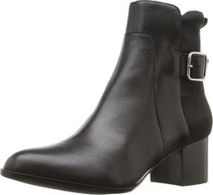 Donald J Pliner Women's Zakki Black Calf Shoe. The Zakki bootie is edgy, sexy and perfect for every season. Leather upper with textile at rear. Side zipper closure. Adjustable buckle for fit. Pointed toe. Man-made lining. Lightly-padded footbed. Stacked block heel. Synthetic outsole. Imported. Measurements: Heel Height: 2 in Weight: 14 oz Circumference: 9 in Shaft: 6 1⁄2 in Product measurements were taken using size 9, width M. Please note that measurements may vary by size.