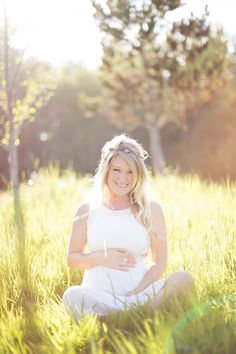 White Maternity gown. By the pond. Golden hour in the grass