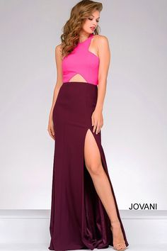 Floor length burgundy and fuchsia fitted sleeveless gown features a halter neckline, front cutout, thigh high slit and hidden zipper in the back.