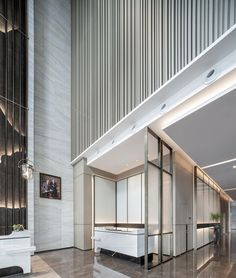 white marble floor and decor Hotel Lobby Design, White Building, Marble Floor, Marble Tiles, Marriott Hotels, Wall Cladding, Model Homes, Building Materials, White Marble