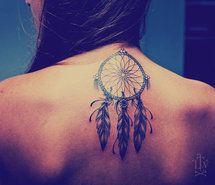 Dream Catcher tattoo in between shoulder blades on back