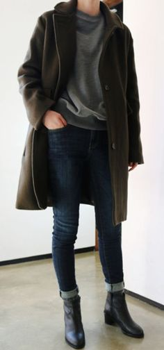 Black ankle boots can even make jeans and a sweatshirt look put together.