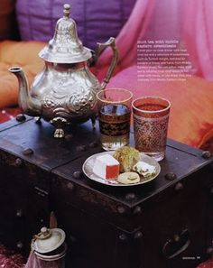love the moroccan tea pot and glasses... Short table and cushions or short stalls
