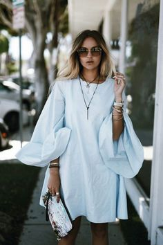21 Genius Summer 2016 Outfit Ideas to Steal: A Shoppable Guide | Nina Suess wearing a short summer dress with oversized sleeves: