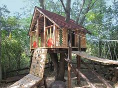 Talk about a devoted grandpa! This one built a tree fort with ropes and pulleys that bring toys and food up, a sandbox below, and a zip-line that brings one out through the opening between the two orange suns for his grandkids. See more at thisoldhouse.com