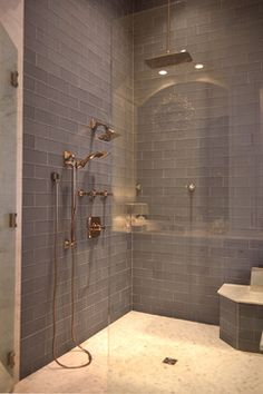 Beautiful 'Ice' Grey glass tile in shower, walk in, bench, brass fixtures