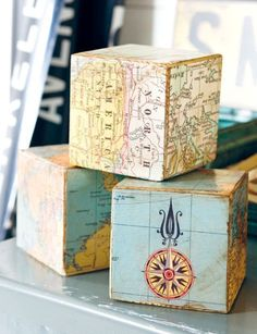 Decoupage building blocks with nautical maps... then add them to a shelf... or mantel! Featured on CC: www.completely-co...