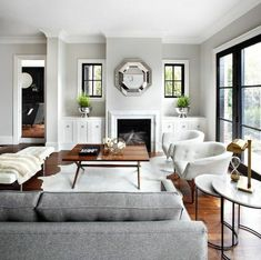 Light Gray Walls Living Room Transitional With Gray Sofa Cowhide Rug