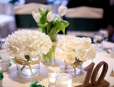 Keeping things simple, centrepieces allow for contempoary statements about your like's and dislike's and a reflection of your relationship as the newly married couple. Employ your use of imagination with the centerpieces they are a focal point!