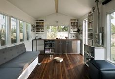 Open floor plan tiny house! Finally, a small space that doesn't feel cramped and like everything is stacked on top of each other.