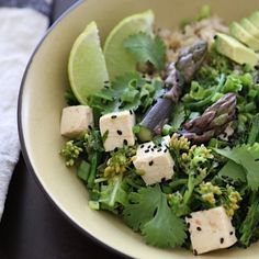 Spring Rabe, Asparagus and Tofu Bowl. Recipe on blog. #petitworldcitizen #springrabe #asparagus #tofu #healthyfood #healthy #vegetables #vegetarian #vegan #spring #savoryfood #farmersmarket