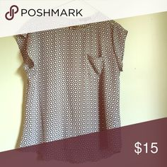 Silky pocket tee An adorable pocket tee for any occasion! Wear it with jeans or tuck it into a pencil skirt for work. The pattern is beautiful, and the grey-white-black color combo works anywhere and with almost anything! Polyester. Excellent condition. Violet & Claire Tops Tees - Short Sleeve