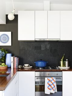 contrast kitchen with beautiful textured backsplash
