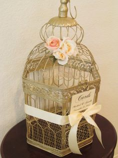 Champagne Gold Birdcage Wedding Cardholder with Blush and Ivory Roses Customized XLC002, $105.00 (http://www.birdcageweddingcardshop.com/champagne-gold-birdcage-wedding-cardholder-with-blush-and-ivory-roses-customized-xlc002/)