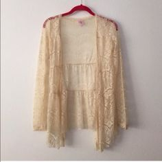 Beige lace layering sweater Cute lacy top, perfect for adding layers and texture to a look. Size small, no buttons on the front. Sweaters