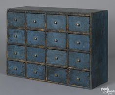 Pennsylvania painted poplar apothecary cupboard, 19th c., retaining an old scrubbed blue surface, 18 1/4'' h., 26'' w.